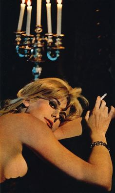 Catherine Deneuve & a chandelier
