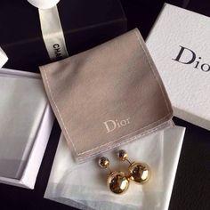 Dior Gold earrings.