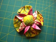 Tea Cup flower, shown on a headband, key ring, brooch and shoe decoration. by ginger.howard.7