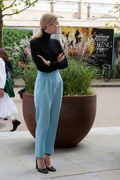 Powder blue high waisted trousers and a black roll neck top - classic!