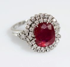 A vivid red Burma unheated ruby ct.5.10 & diamonds cocktail ring