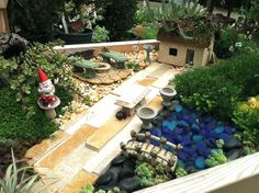 #fairygarden. Create a miniature garden display with gnomes, fairy ornaments, and dwarf plants. Items available at pipkinsmarket.com