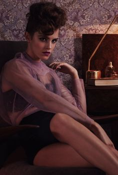 Emma Watson wears black silk high-waisted pants and black lace bra (both worn throughout) both by DOLCE & GABBANA and sheer lilac top by MIU MIU. Wonderland Magazine, February 2014