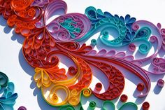 Quilling art; rolling strips of paper and gluing them standing on edge to make a picture.