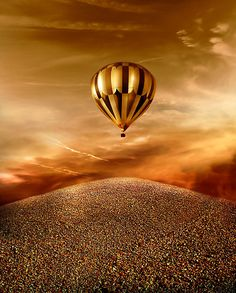 Hot Air Baloon in a golden sky flying upward very high...do I love it...yes I do...gold skys, gold earth then there's you.