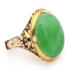 A jade and 14k gold ring