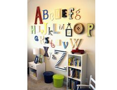 Make a cute ABC display. Head to the craft store for some assorted sizes of wooden letters and paint them in different colors and designs. Then put them up on baby's wall in lines. www.thebump.com