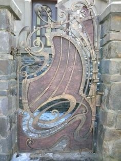 Metalwork - the colours and textures in this gate blend in so well with the stonework supporting it.