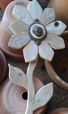 "Reclaimed Wood Flower Rustic Wall Decor  $24.50   Measures 11"" X 6""."