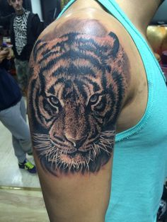 tiger - by Marci Blazsek tattoo right arm/shoulder