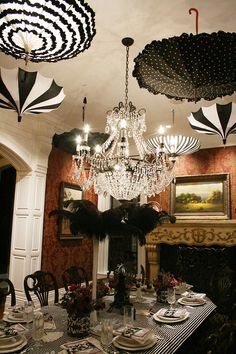 French inspired dinner party. Decorated with black and white umbrellas from Bella Umbrella.