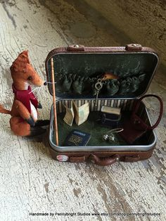 The Traveller: Pocket Tin Miniatures - A travel suitcase and jointed fabric fox in a peppermint altoid tin