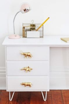 Or go for the playfully glam look and make knobs out of plastic dinosaurs: | 31 Gorgeous Furniture Upgrades That Only Look Expensive