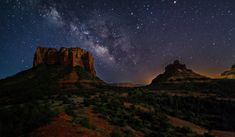 https://flic.kr/p/J78XGZ | Cosmos Over Courthouse | The Milky Way rises between Courthouse Butte and Bell Rock near Sedona, Arizona. The glow behind Bell Rock (right) comes from the Village Of Oak Creek (a satellite community of Sedona). The landscape was illuminated by a one third moon.