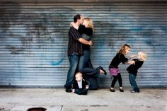 Love this picture, but this link has lots of great poses for family pictures.