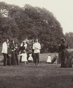 Empress Alexandra of Russia taking a picture of the royal family in Denmark.