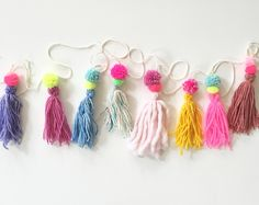 This handmade garland has it all! Pom Pom's,tassels and loaded with colors. This is a cute unexpected baby shower gift or party decor and everyday garland!  6ft