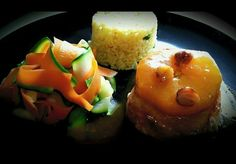 Pork medallion with an orange, ginger and hazelnut sauce served with spiced rice and carrot & zucchini ribbons