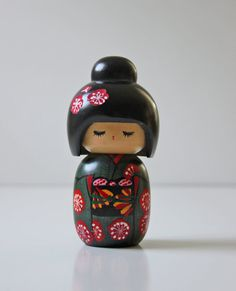 wooden kokeshi doll black robe red flowers