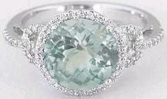Featuring a lovely round aquamarine and laden with micropave set diamonds, this beautiful ring is both decidedly feminine and right on trend as well. Green Amethyst Engagement Ring, Amethyst And Diamond Ring, Gemstone Engagement Rings, Halo Diamond Engagement Ring, Topaz Ring, Amethyst Gemstone, Diamond Rings, Aquamarin Ring, Quartz Ring