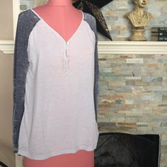 te verde burnt out top Light grey with dark grey sleeves. Has a scroll detail on both sleeves. Has some piling see 4th photo. No rips or stains. No trades. Tops