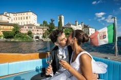 A kiss on the boat transfer after the ceremony in orta san giulio