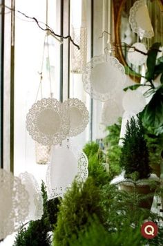 beautifully done. hanging-doilies-decor