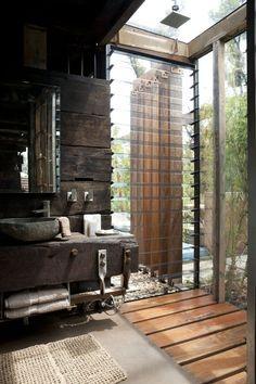 Inside outside bathroom. Glass Louvred window. Rain shower. Reclaimed wood vanity