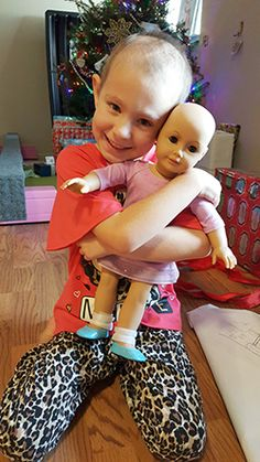 Photograph of Reese and her doll  © UC Regents