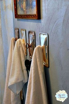 silver chafing dish lids as towel hooks