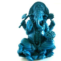 A ganesh statue in azure blue. Modern asian decor great for a spiritual alter.  Decorate your home with unique bohemian pieces like this ganesh statue. $34US