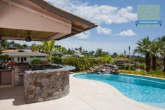 Hydrazzo Jamaican Mist is a smooth, polished finish that adds to this relaxing backyard setup. Huber Pool, Maui's Premier Custom Pool Builder #swimmingpool #pool #hydrazzo