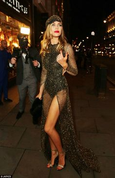 All that glitters: Abbey Clancy put on a very cheeky display in a revealing sheer dress speckled with gold for her 1920s-themed 30th birthday party at the Rah Rah Room night club on Saturday