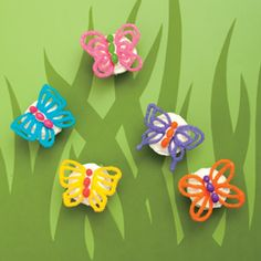 butterfly wings made from melted chocolate and sprinkled with decorating sugar, jellybeans make up the body - on top of cupcakes or a cake.