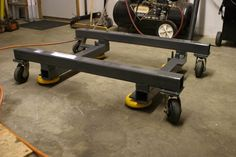 Bridgeport Dolly by gda -- Homemade dolly intended for a Bridgeport mill. Fabricated from square steel tubing and equipped with vibration isolation feet. Caster-mounted for enhanced mobility. http://www.homemadetools.net/homemade-bridgeport-dolly