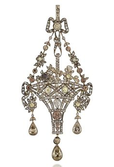 A COLOURED DIAMOND AND DIAMOND PENDANT. Designed as an openwork basket of flowers, with garland connections to a ribbon bow surmount, set throughout with old and rose-cut diamonds interspersed with coloured diamond accents, suspending three old-cut pear shaped diamond drops, pin fitting to the reverse.