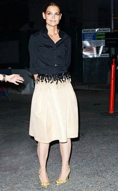 Katie Holmes wears a button-down shirt, embellished knee-length skirt, and round-toe pumps