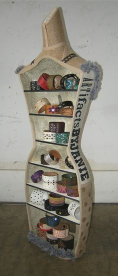 A mannequin repurpose into a shelf to display bracelets for craft fairs and like events.