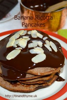 Gluten Free Banana and Ricotta Pancakes with Dark Chocolate Sauce and Toasted Flaked Almonds.