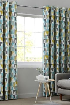 These Next curtains would go great with the geometric pattern in the sofa…