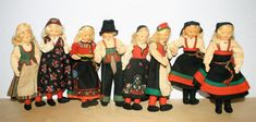 Adorable little Norwegians in their bunader ! Represented here are Heddal, Hallingdal, Trøndelog, Setesdal, Rogaland & Hardanger. In the 7 line, these cuties are the creations of Rønnaug Petterssen. Three of them are older with tab arms while the others have posable wire armature arms. As you can see by the pictures, they are of nice vintage wear with just enough color aging. Nice little grouping 7 Line, Vintage Wear, Dna, Doll Clothes, Arms, Arts And Crafts, Costumes, Dolls, 1920s