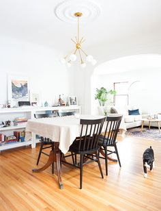 Transitional dining room with modern chandelier & Duncan Phyfe style table - at home with francios et moi. - sfgirlbybay