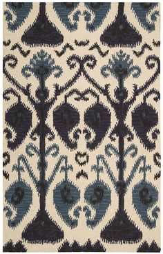 Nourison's Siam Collection SIA02 Beige. Made from 100% wool and hand-tufted in India, this sensational rug features a dynamic, boldly-scaled Ikat motif in stunning shades of navy, beige and ocean blue for a vibe that is both chic and cozy.