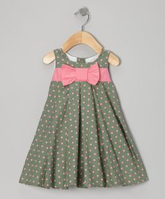 Two great colors on one great dress. Pink and green spots pop off a swing silhouette for a garden-fresh look and feel.