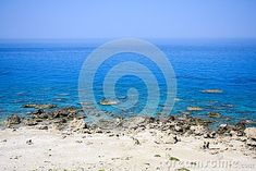 Photo about Rocky beach with beautiful view of the deep blue sea and clear sky above horizon. Image of horizon, gradient, sunny - 106911809 Deep Blue Sea, Clear Sky, Beach, Photos, Photography, Image, Beautiful, Pictures, Photograph