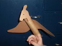 Printable Ptronodon dinosaur made from toilet paper tube from Making Learning Fun.