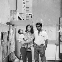 """""""Gary Naidoo with his wife and child. He was sentenced to fine or 50 days imprisonment suspended for three years, for living in a White Group Area at Orion Court, Bree Street in the city, December David Goldblatt, Cityscapes, South Africa, December, Group, Couple Photos, Street, Children, People"""