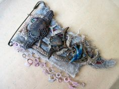 Everything That's You. Textile and Antique Trinkets Rustic Victorian Gypsy Assemblage Brooch. Lace fabric.