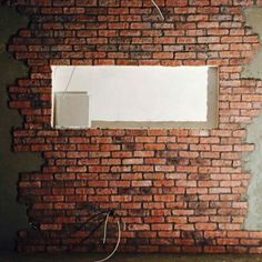 Fabulous Feature Wall using Cottage Red Brick Slips with a Gloss seal. Tiles Uk, Brick Tiles, Stone Cladding, Wall Cladding, Lego Figures, Salford, Peterborough, Red Bricks, Retro Furniture