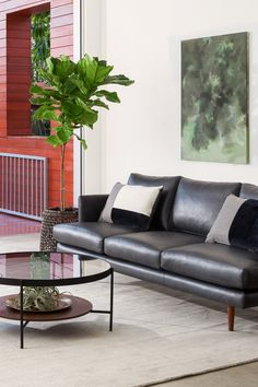 Details on this leather sofa, such as double-stitched seams, hand-folded corners, and waxed Italian leather speak to quality construction, while slender wooden legs offer stability without adding bulk. Mid Century Modern Sofa, Leather Sofa, Black Leather, Comfy Sofa, Black Sofa, Contemporary Sofa, Living Room Decor, Living Rooms, Italian Leather